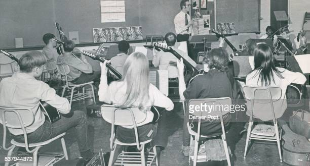 Students Learn To Play Guitars In One Of Several Such Instruction Classes Taught At Smiley Junior High School Gary Dempsey is instructor for the...