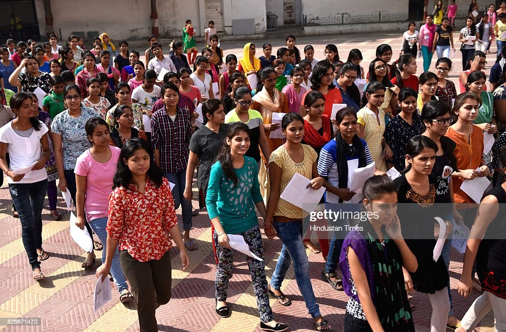 Students leaves for examination entree after they were thoroughly scanned to take the All India Pre-Medical/Pre-Dental Entrance Test (AIPMT) at the examination centre at RK Puram on May 1, 2016 in New Delhi, India. The All Indian Pre-Medical Test (AIPMT) 2016, being treated as the first phase of the National Eligibility Entrance Test (NEET), was held on Sunday. The competitive examination held for entrance to MBBS and BDS courses across the country was held amidst tight security this year. Students had a proper dress code to adhere to as they were not allowed to enter the examination hall in shoes or carry any kind of stationary with them. Mobile phones were also not allowed