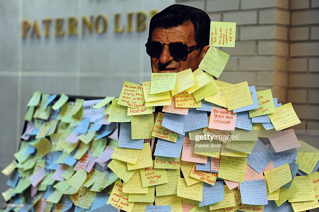 Students leave notes on a cardboard cutout of former Penn State Football coach Joe Paterno in the Pattee and Paterno Libraries on the campus of Penn State on January 24, 2012 in State College, Pennsylvania. Paterno, who was 85, died due to complications from lung cancer on January 22, 2012.