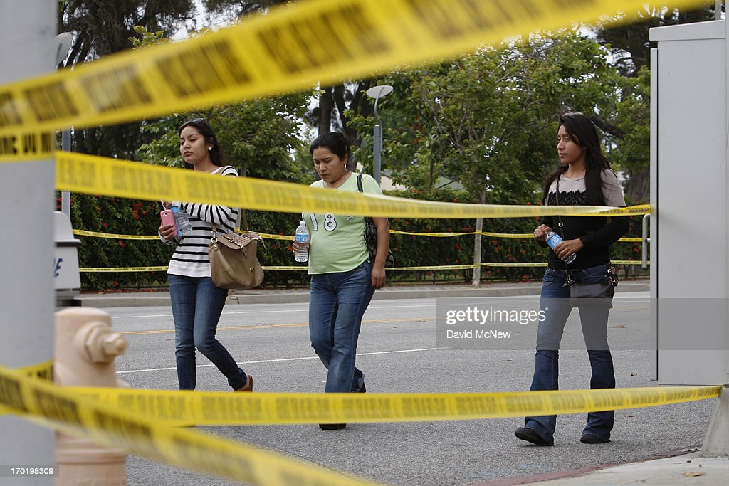Students leave Santa Monica College, which remains closed for a second day as investigators gather evidence from crime scenes, after picking up personal belongings that had to abandon when a gunman on a mass shooting spree entered the campus, on June 8, 2013 in Santa Monica, California. The shootings occurred in various locations about three miles south of a political fundraiser attended by President Barack Obama but Secret Service officials said the two events were not related and that the president was never in any danger. Four people besides the gunman have died from their wounds and five others wounded, including a woman who is close to death.