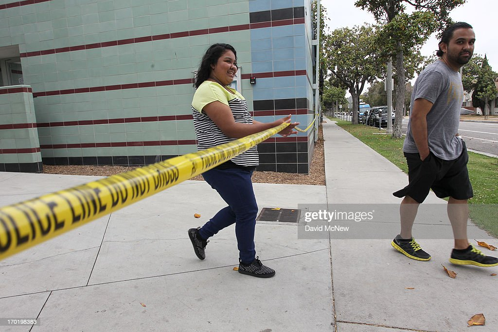 Students leave Santa Monica College, which remains closed for a second day as investigators gather evidence from crime scenes, after picking up personal belongings they had to abandon when a gunman on a mass shooting spree entered the campus, on June 8, 2013 in Santa Monica, California. The shootings occurred in various locations about three miles south of a political fundraiser attended by President Barack Obama but Secret Service officials said the two events were not related and that the president was never in any danger. Four people besides the gunman have died from their wounds and five others wounded, including a woman who is close to death.