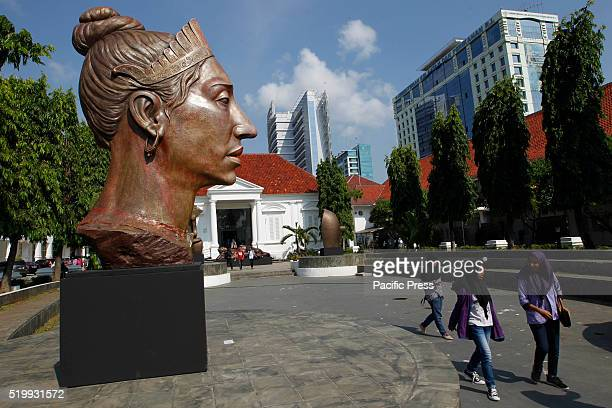 Students leaving the main entrance National Gallery during exhibition by Indonesian artist Purjito in Jakarta during Christmas holiday