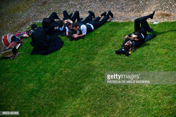 Students lie on the grass at Evora University where Chilean President Michelle Bachelet will be awarded an honorary doctorate in Evora Alentejo on...