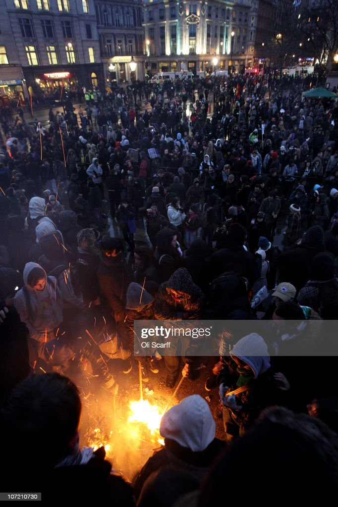 Students light a fire in Trafalgar Square as they take part in a protest over the Government's budget cuts and proposed rise in tuition fees on November 30, 2010 in London, England. Hundreds of students evaded police containment tactics and marched throughout Westminster and the City of London from Trafalgar Square in the third major protest of its kind in London in as many weeks.