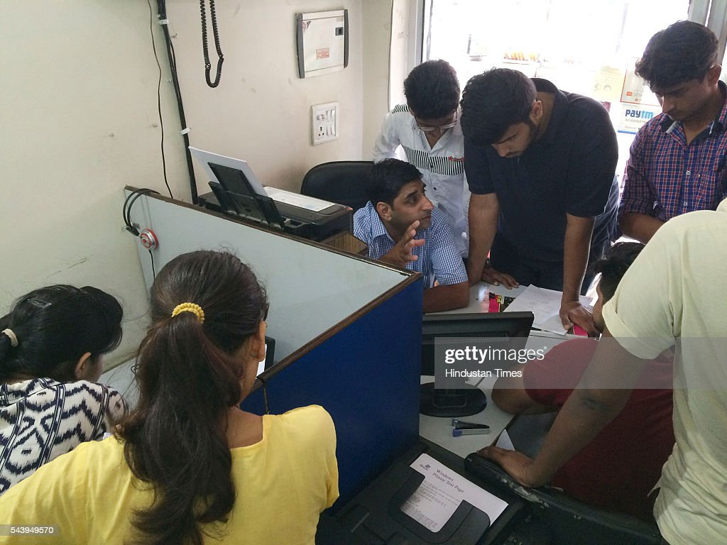 Students line up at a cyber cafe to procure print outs for admission slips. Delhi University admissions commenced in the south campus on June 30, 2016 in New Delhi, India. Delhi University came out with its first cut off list last night.