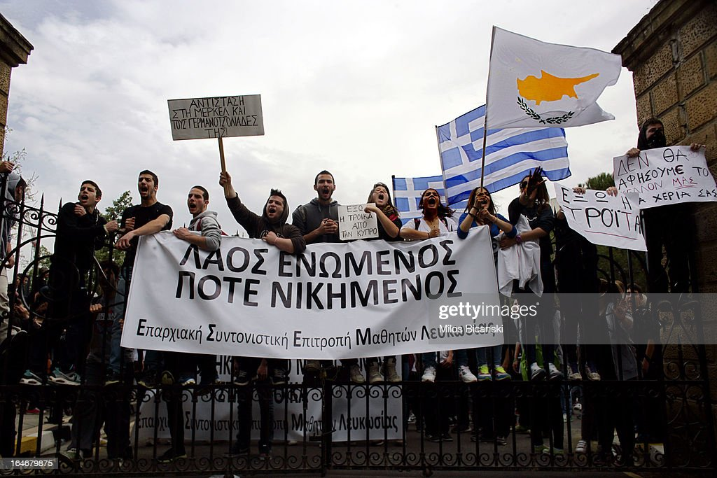 Students line up near the gate of the Cypriot Presidential house as they protest against austerity measures in front of Cypriot Presidental house on March 26, in Nicosia, Cyprus. After days of negotiation, Eurozone finance ministers have agreed terms for a 10 billion euro bailout deal, which aims to prevent the collapse of Cypriot banks and ensure that Cyprus remain in the Eurozone. The agreement, which has been described by Cyprian politicians as 'painful,' will see large bank account holders suffer big losses.