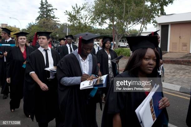 Students line up to attend their graduation ceremony at the University of the Free State in Bloemfontein South Africa Races are mixing more but often...