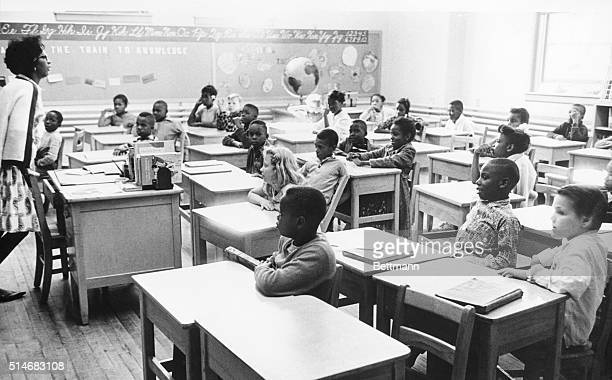 Students listen as a teacher at recently desegregated Bethune Elementary School teaches a class of integrated students