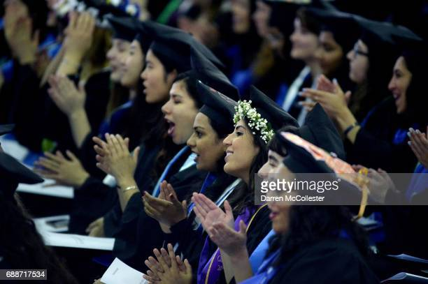 Students listen as Hillary Clinton speaks at commencement at Wellesley College May 26 2017 in Wellesley Massachusetts Clinton graduated from...