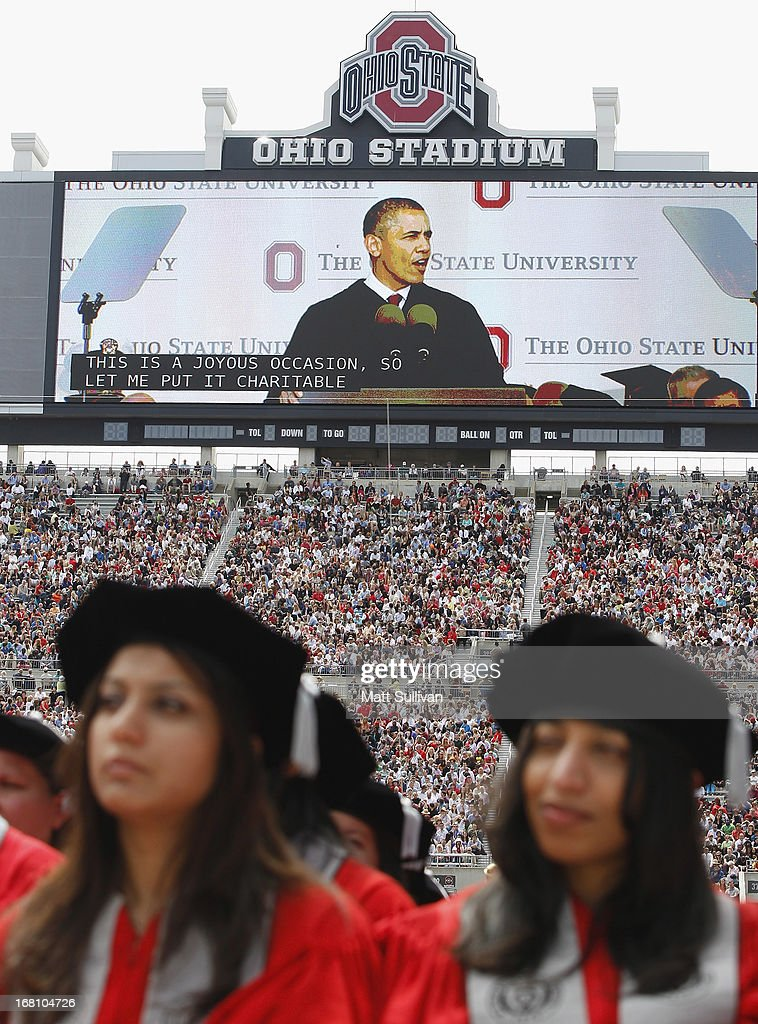 Students listen as President <a gi-track='captionPersonalityLinkClicked' href=/galleries/search?phrase=Barack+Obama&family=editorial&specificpeople=203260 ng-click='$event.stopPropagation()'>Barack Obama</a> delivers his commencement address to the graduating class of The Ohio State University at Ohio Stadium on May 5, 2013 in Columbus, Ohio.