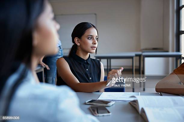 Students listening to co-student in group