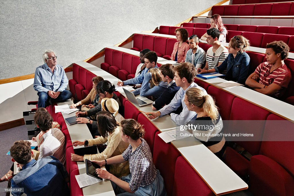 Students listening to teacher in class