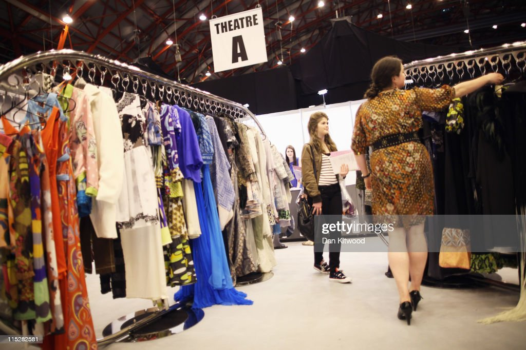 Students look at an exhibition stand during Graduate Fashion Week at Earls Court on June 6, 2011 in London, England. The event which began in 1991 showcases emerging talent from BA Graduate fashion design courses across the UK and includes exhibition stands and catwalk shows from around 50 universities.