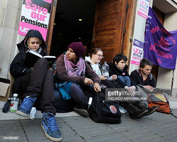 Students man a picket line outside the School of Oriental and African Studies in London on November 30 as they take part in a national strike against...