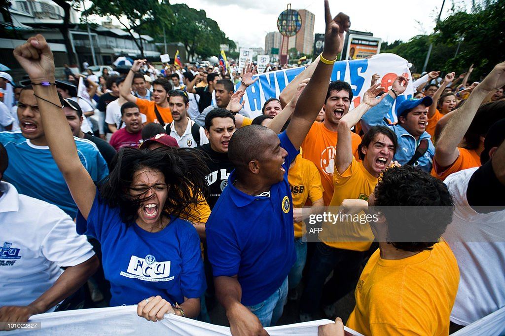 Students march and shout slogans during a protest of students and teachers in demand of a higher budget for educaction in Caracas on May 27, 2010. AFP PHOTO / Miguel GUTIERREZ