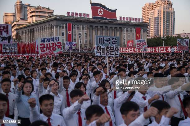 Students march during a mass rally on Kim IlSung sqaure in Pyongyang on September 23 2017 Tens of thousands of Pyongyang residents were gathered in...