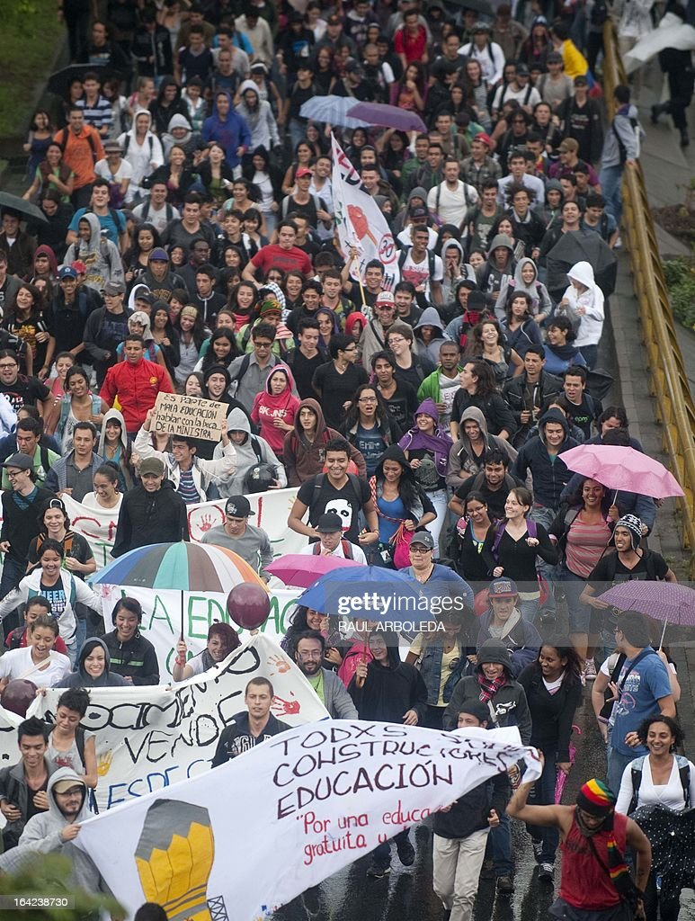 Students march during a protest in Medellin, Antioquia department, Colombia on March 21, 2013, demanding a better and free education and an alternative university reform . AFP PHOTO/Raul ARBOLEDA