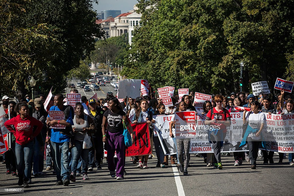 Students march from the Lincoln Memorial to the U.S. Supreme Court prior to the hearing of 'Schuette v. Coalition to Defend Affirmative Action' on October 15, 2013 in Washington, DC. The case revolves around affirmative action and whether or not states have the right to ban schools from using race as a consideration in school admissions.