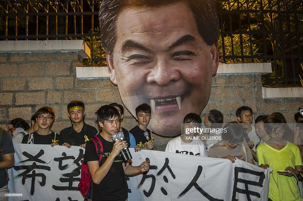 Students march to the Government House in Hong Kong on September 25 2014 to push the Chief Executive Leung Chun Ying to acknowledge the grevancies...
