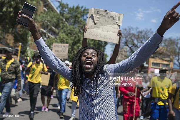 Students march towards Prime Ministry building as they shout slogans and hold banners during a protest against the increase of tuition fees at South...