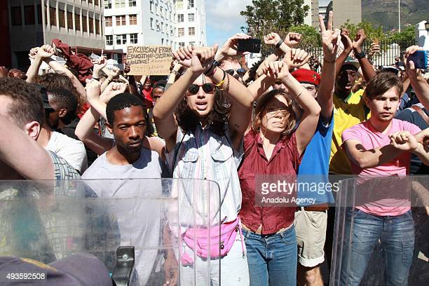 Students march towards the Parliament building in Cape Town South Africa on October 21 2015 during a protest against fee hikes Universities in Cape...