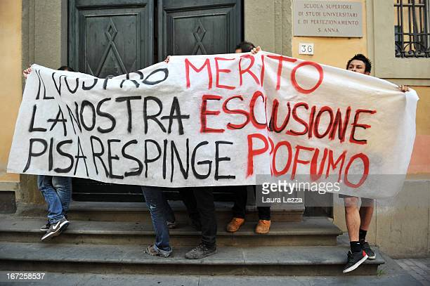 Students march with a banner against the Government during a demonstration outside the Scuola Superiore Sant'Anna on April 23 2013 in Pisa Italy...