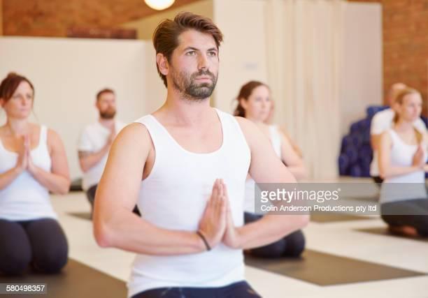 Students meditating in yoga class