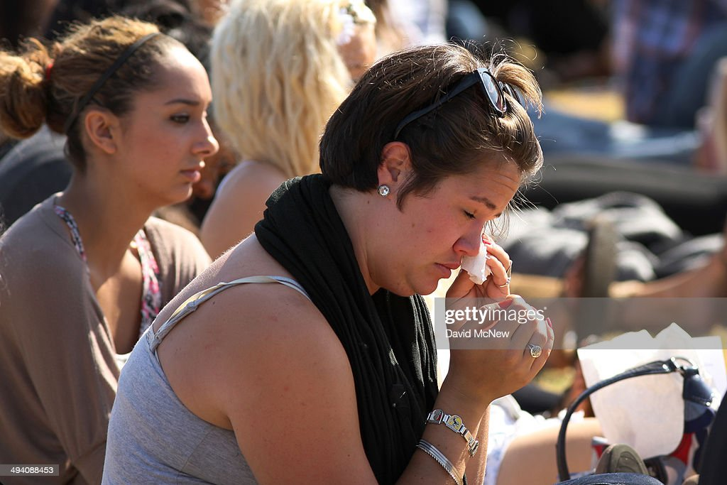 Students mourn at a public memorial service on the Day of Mourning and Reflection for the victims of a killing spree at University of California, Santa Barbara on May 27, 2014 in Isla Vista, California. Elliot Rodger killed six college students at the start of Memorial Day weekend and wounded seven other people, stabbing three then shooting and running people down in his BMW near UCSB before shooting himself in the head as he drove. Police officers found three legally-purchased guns registered to him inside the vehicle. Prior to the murders, Rodger posted YouTube videos declaring his intention to annihilate the girls who rejected him sexually and others in retaliation for his remaining a virgin at age 22.