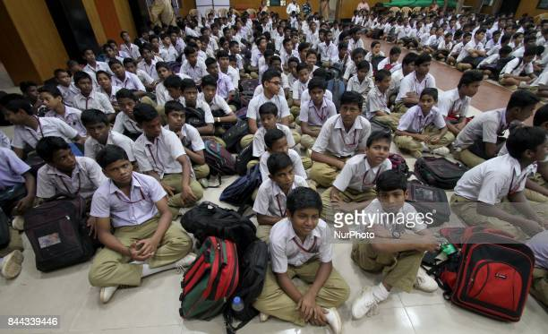 Students of a government school sit in an awareness program organized by social workers about the adolescents of mental health on the International...
