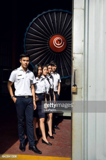 Students of Aviation University in airplane hangar