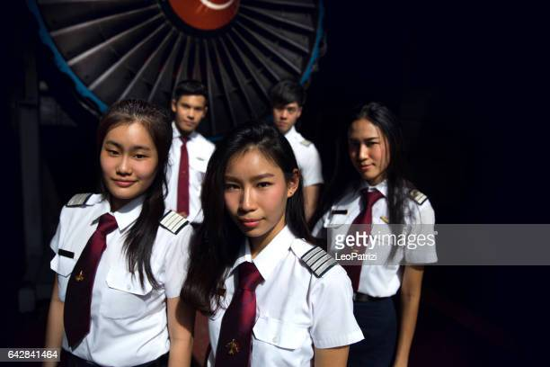 Students of Aviation University in airplane hangar