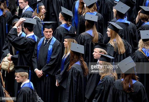 Students of Bonn university with gown and cap during exam celebration graduation ceremony