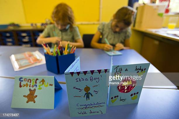 Students of Buckleberry Church of England Primary School draw congratulatory cards for the Duke and Duchess of Cambridge celebrating the birth of...