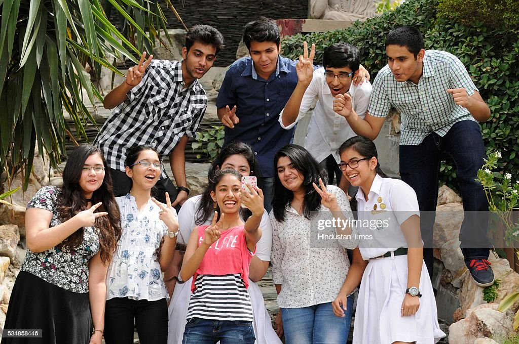 Students of Delhi Public School (DPS) celebrate after Central Board of Secondary Education (CBSE) class 10th board exam results were announced, on May 28, 2016 in Noida, India. A total of 1,68,541 students, out of 14,31,861 who cleared the Central Board of Secondary Education (CBSE) Class 10 board examination, scored a perfect 10 Cumulative Grade Point Average or CGPA score. There were 85,316 boys and 83,225 girls in the list of perfect scorers this year. The total pass percentage stands at 96.21 per cent, but it has fallen compared to the previous year in which 97.32 per cent students passed the examinations.
