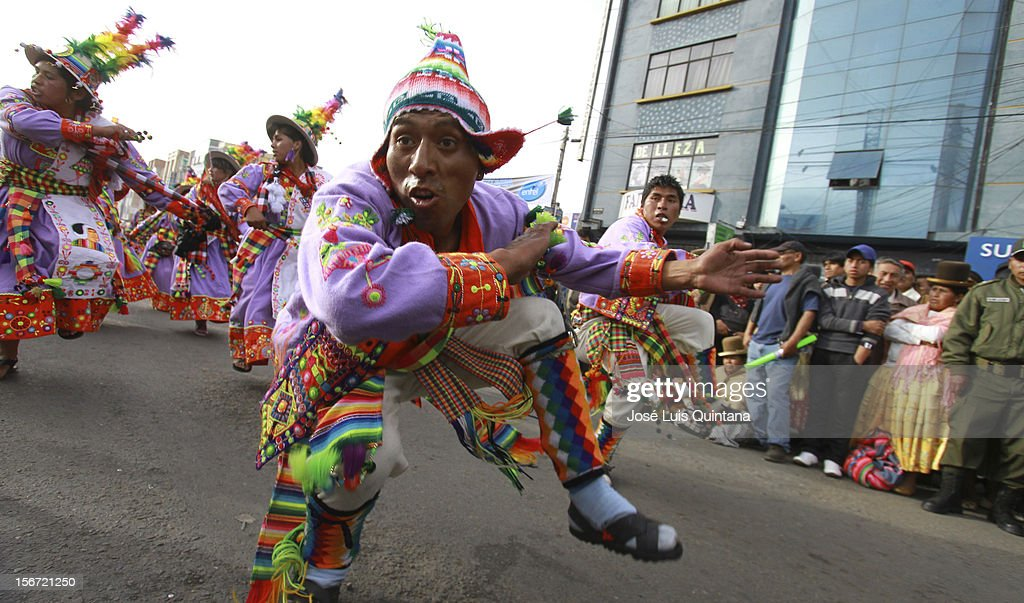 """Students of Education at the Public University of El Alto (UPEA), situated at an altitude of 4,000 meters above sea level on top of the Hoyada city of La Paz, play ZAMPOÑADA in Avenida Juan Pablo II on November 17, 2012 in La Paz, Bolivia. 39 youth fraternities participate of the IX version of the """"Entrada Universitaria de la UPEA' celebrating the University Autonomy achieved by Lax: 2556 on November 12, 2003 and promulgated by President Carlos D. Quisbert Mesa."""