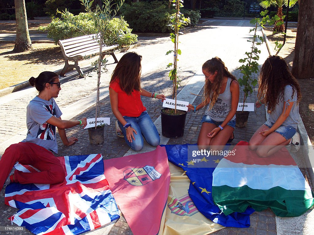 Students of Galilei Costa High school prepare to plant three trees to celebrate the birth of George Alexander Louis, the baby boy of Britain's Prince William and his wife Kate on July 25, 2013 in Lecce.