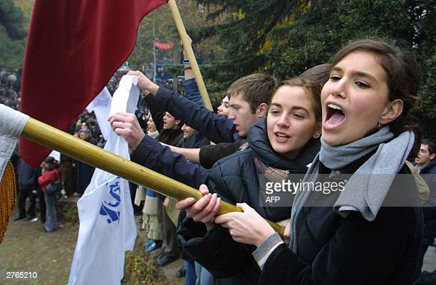 Students of Georgian State University shout during a rally against the resignation of their rector in Tbilisi 27 November 2003 Georgia's parliament...