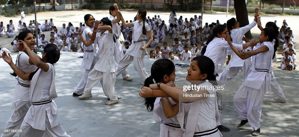 Students of Government Girls Senior Secondary School learning marshal arts for the self defence at Roop Nagar near North Delhi University on April 22, 2013 in New Delhi, India. According to statistics released by Delhi Police today, capital reported 463 rape cases this year till April 15 as against 179 during the same period last year. While molestation cases showed 600 per cent rise this year from 139 to 973 cases, eve teasing cases increased by 783.67 per cent, from 49 to 433 cases.