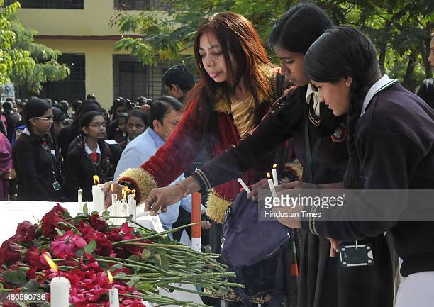 Students of Govt Subhash HS School paying tribute to the victims of Peshawar school attack on December 17 2014 in Bhopal India 141 people including...