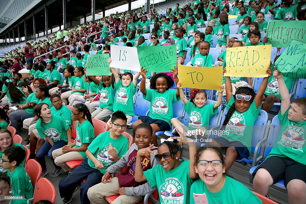 Students of J.A. Hargrave Elementary cheer during the Speeding To Read Championship Assembly at Texas Motor Speedway on May 24, 2016 in Fort Worth, Texas.
