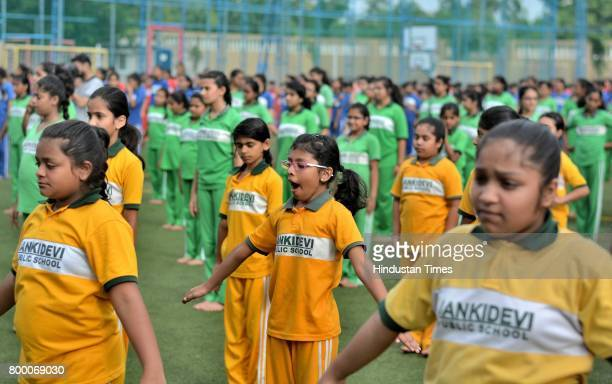 Students of Jankidevi Public School take part in a mass yoga session on the International Yoga Day at The SV Patel Nagar Andheri West on June 21 2017...
