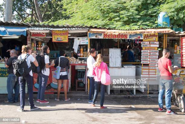 Students of Medicine lifestyle economic changes allow small private business to sell snacks and lunch from tin roofed shacks close to the Medicine...