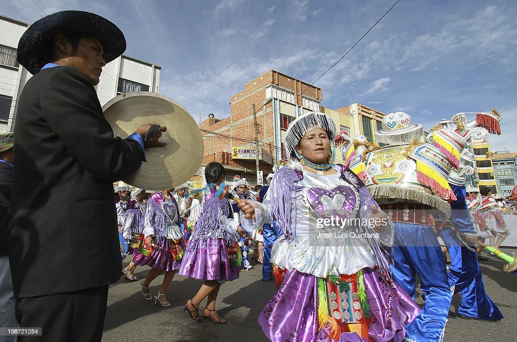 "Students of Nursing at the Public University of El Alto (UPEA), situated at an altitude of 4,000 meters above sea level on top of the Hoyada city of La Paz, play ZAMPOÑADA in Avenida Juan Pablo II on November 17, 2012 in La Paz, Bolivia. 39 youth fraternities participate of the IX version of the ""Entrada Universitaria de la UPEA' celebrating the University Autonomy achieved by Lax: 2556 on November 12, 2003 and promulgated by President Carlos D. Quisbert Mesa."