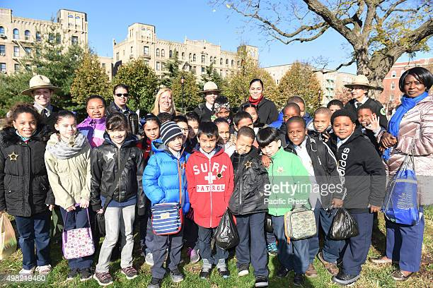 Students of PS 35 Franz Siegel elementary at Joyce Kilmer Park Mayor de Blasio former mayor Mike Bloomberg and Bette Midler joined other city leaders...