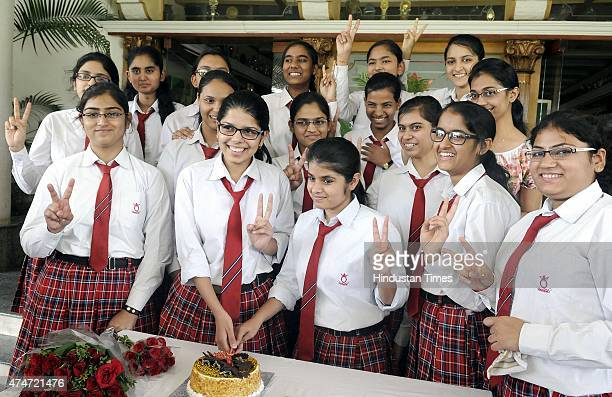 Students of Queens College Indore celebrating their success in CBSE class 12th board exam on May 25 2015 in Indore India Overall girls have done...