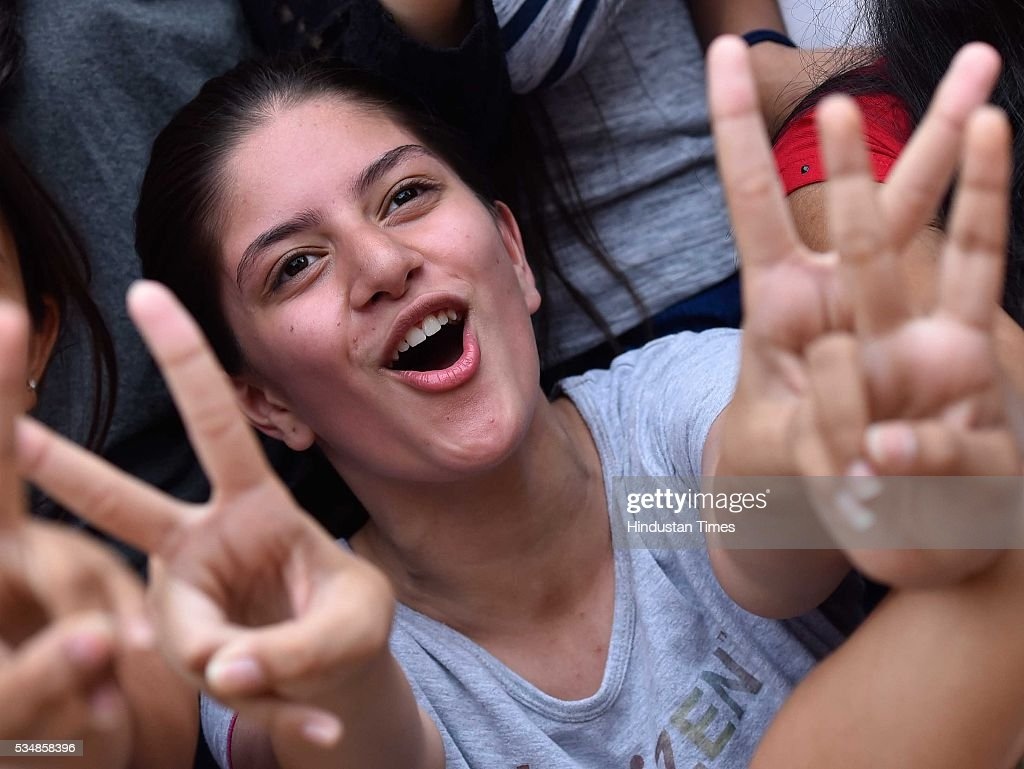 Students of St. Thomas School celebrate their success after Central Board of Secondary Education (CBSE) class 10th board exam results were announced, on May 28, 2016 in New Delhi, India. A total of 1,68,541 students, out of 14,31,861 who cleared the Central Board of Secondary Education (CBSE) Class 10 board examination, scored a perfect 10 Cumulative Grade Point Average or CGPA score. There were 85,316 boys and 83,225 girls in the list of perfect scorers this year. The total pass percentage stands at 96.21 per cent, but it has fallen compared to the previous year in which 97.32 per cent students passed the examinations.