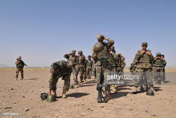 Students of the Afghan security forces belonging to the NCOBC attend a training supervised by Italian military advisors of the NTMA on August 27 2011...