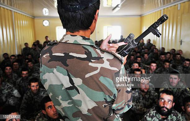 Students of the Afghan security forces belonging to the TLC attend a lecture on weapons supervised by some Italian military advisors of the NTMA on...