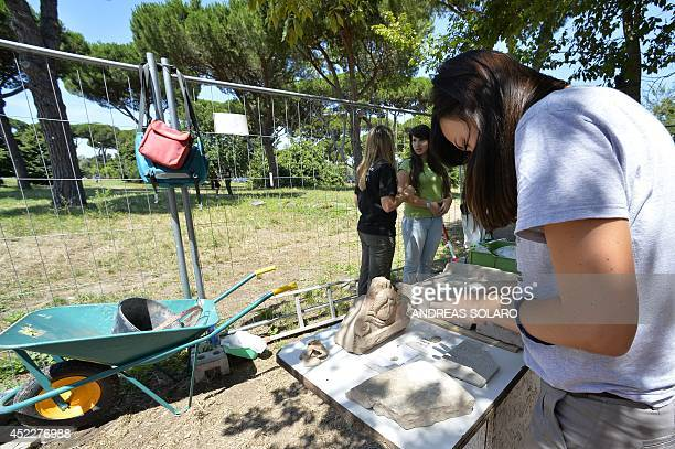 Students of the American Institute for Roman Culture work at the Parco dei Ravennati excavation site in Ostia Antica on July 17 2014 near Rome The...