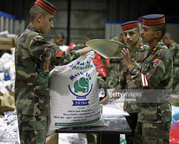 Students of the Army's Technical College prepare supplies for the victims of Tropical Storm Stan 08 October 2005 in Guatemala City Some 1400 people...